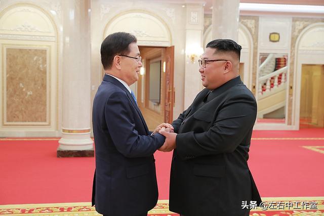 我国安全保卫室事务长郑义溶在朝鲜平壤与北朝鲜最高领导人金正恩