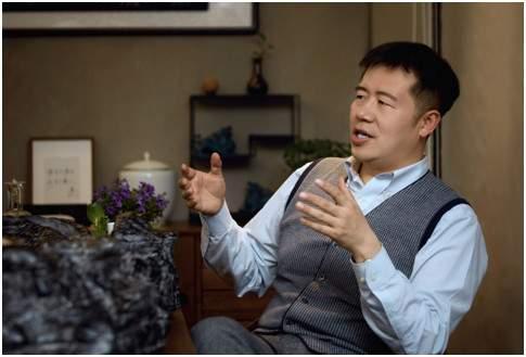 连界董事长王玥邀专家学者赴由新书店话谈房地产未来